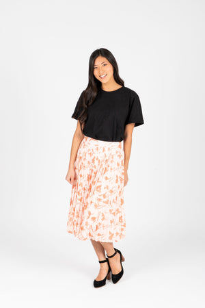 The Jenna Floral Pleated Skirt in Blush, studio shoot; front view