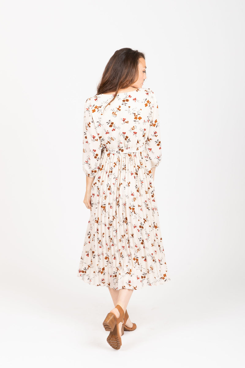 The Watts Floral Pleated Wrap Dress in Ivory, studio shoot; back view