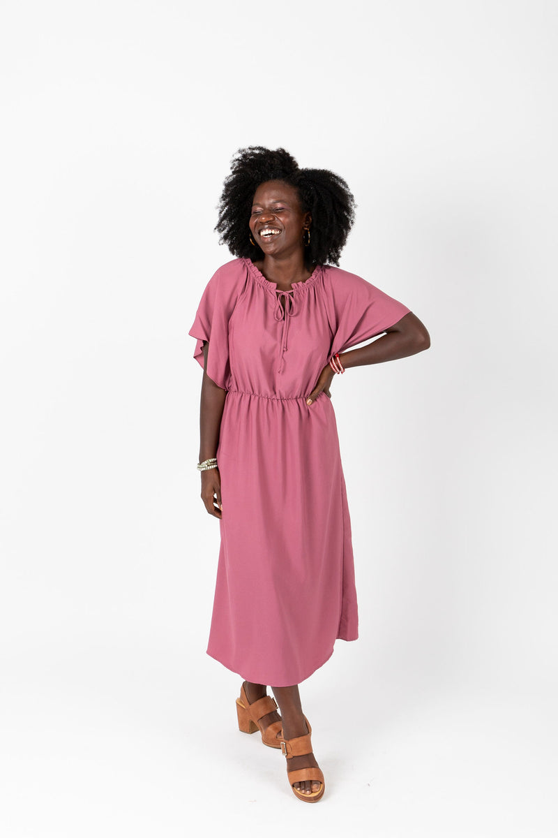 The Katee Ruffle Empire Dress in Mauve, studio shoot; front view