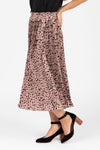 The Naldi Animal Print Smocked Skirt in Blush, studio shoot; side view