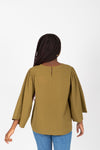 The Lunette Embroidered Blouse in Moss, studio shoot; back view