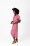The Katee Ruffle Empire Dress in Mauve, studio shoot; side view