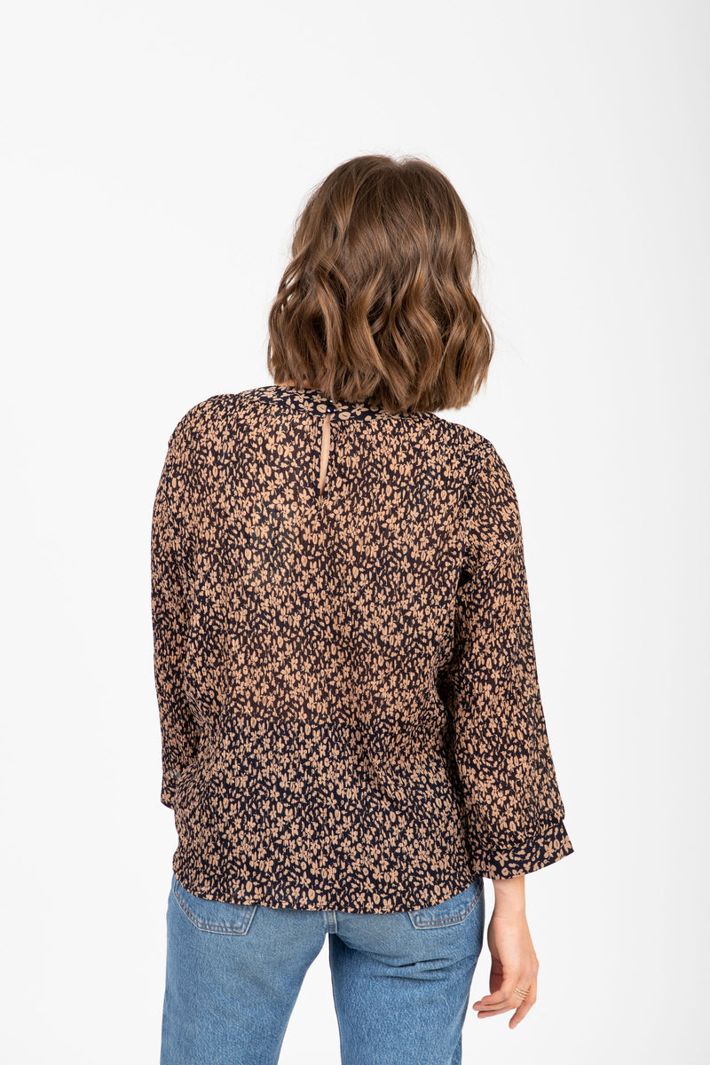 The Bleu Patterned Blouse in Black, studio shoot; back view