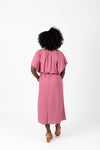The Katee Ruffle Empire Dress in Mauve, studio shoot; back view