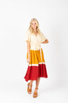 The Ted Colorblock Pleated Dress in Mustard, studio shoot; front view