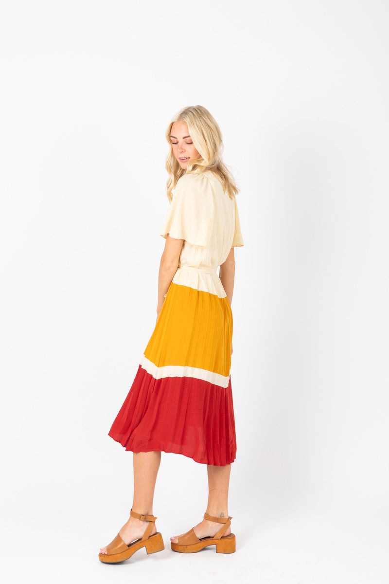 The Ted Colorblock Pleated Dress in Mustard, studio shoot; side view