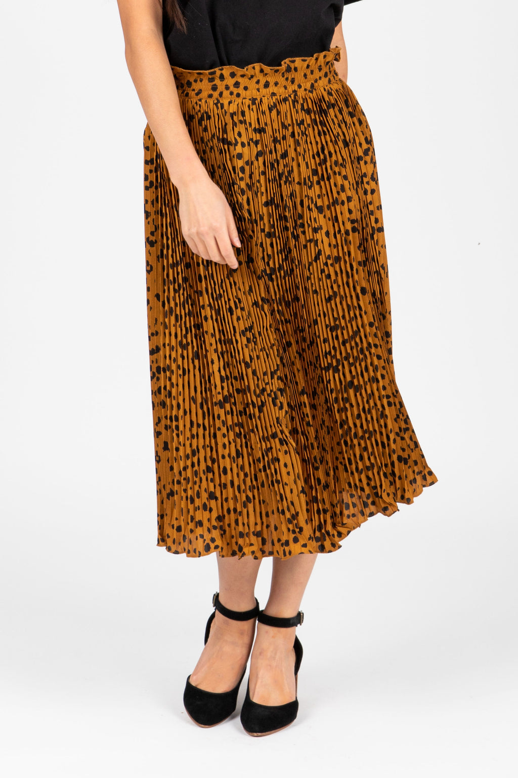 The Naldi Animal Print Smocked Skirt in Camel, studio shoot; front view