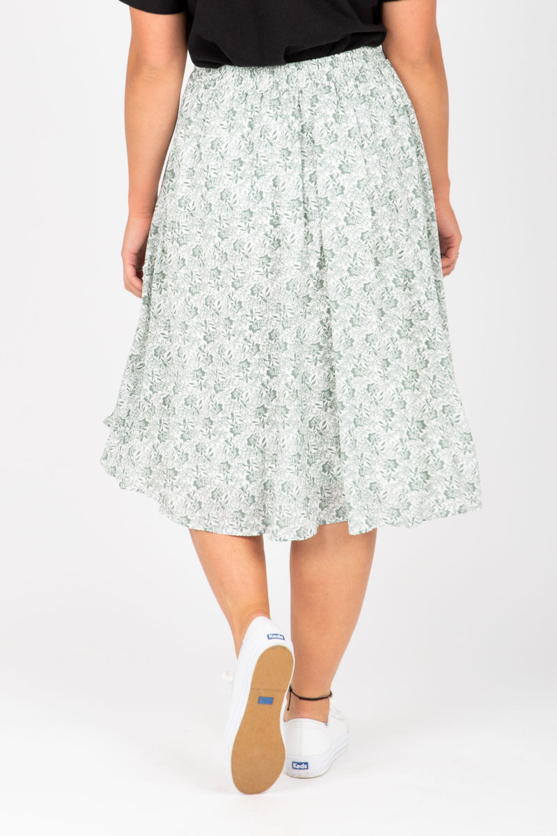 The Emely Floral Midi Skirt in Sage, studio shoot; back view