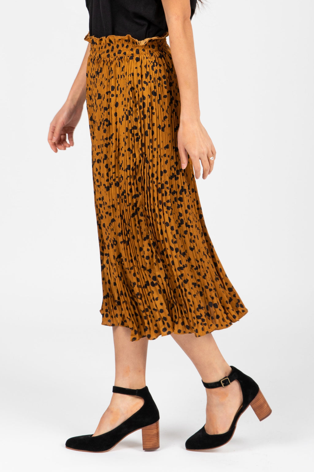 The Naldi Animal Print Smocked Skirt in Camel, studio shoot; side view