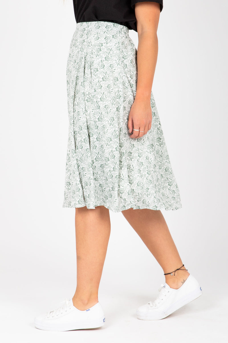 The Emely Floral Midi Skirt in Sage, studio shoot; side view