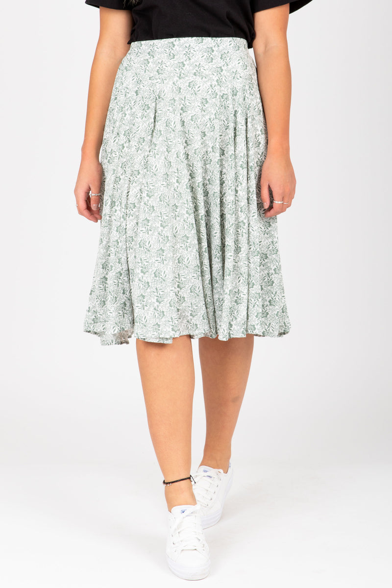The Emely Floral Midi Skirt in Sage, studio shoot; front view