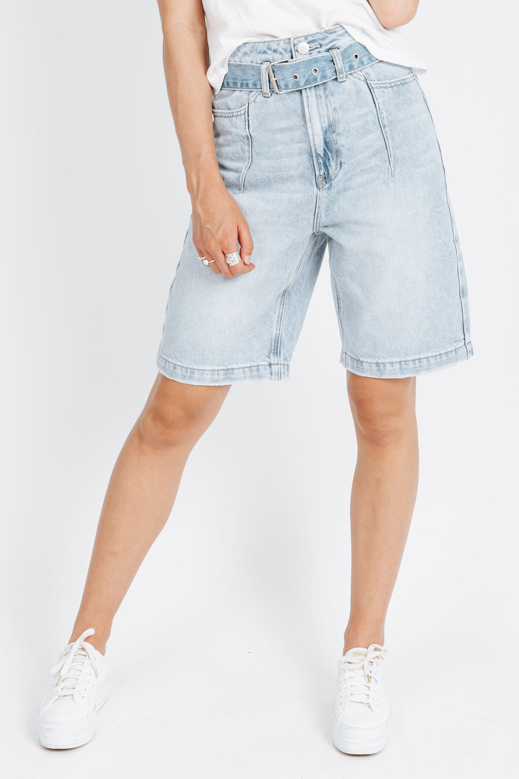 The Radford Belted Denim Short in Light Blue Wash, studio shoot; front view