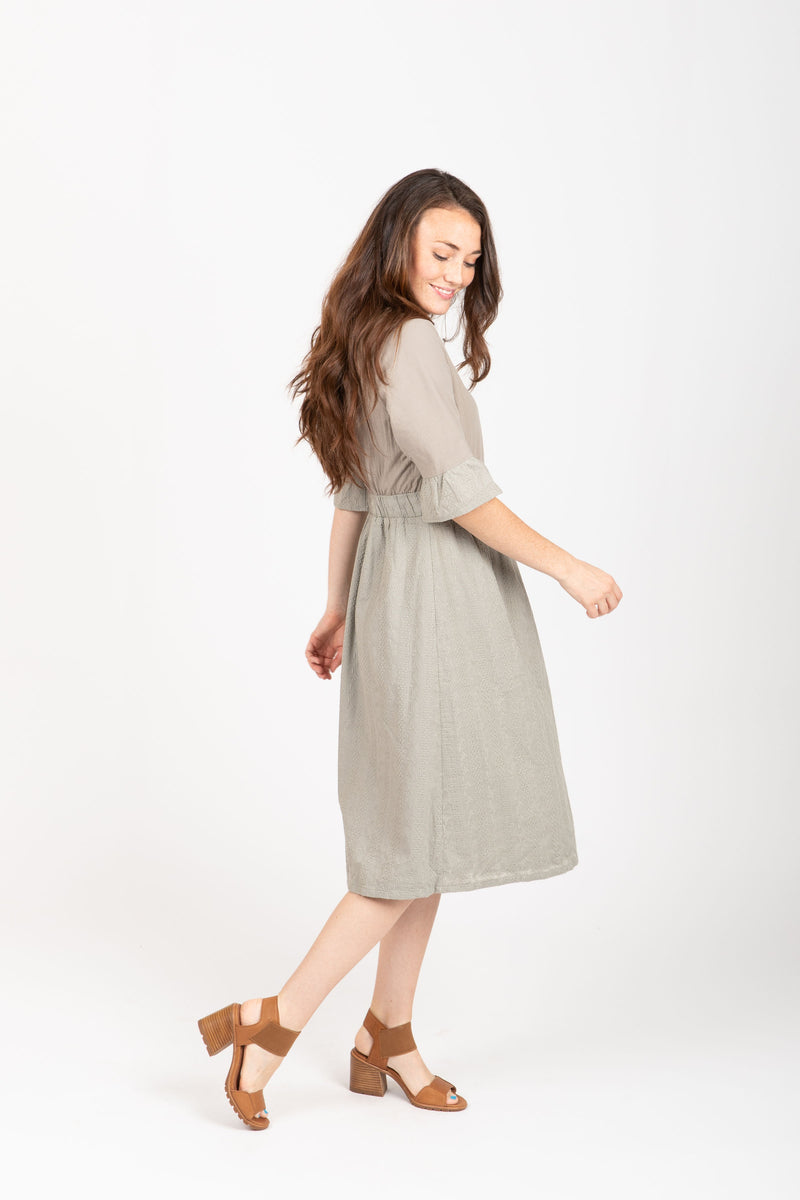 The Colby Ruffle Detail Dress in Sage, studio shoot; side view