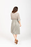 The Colby Ruffle Detail Dress in Sage, studio shoot; back view