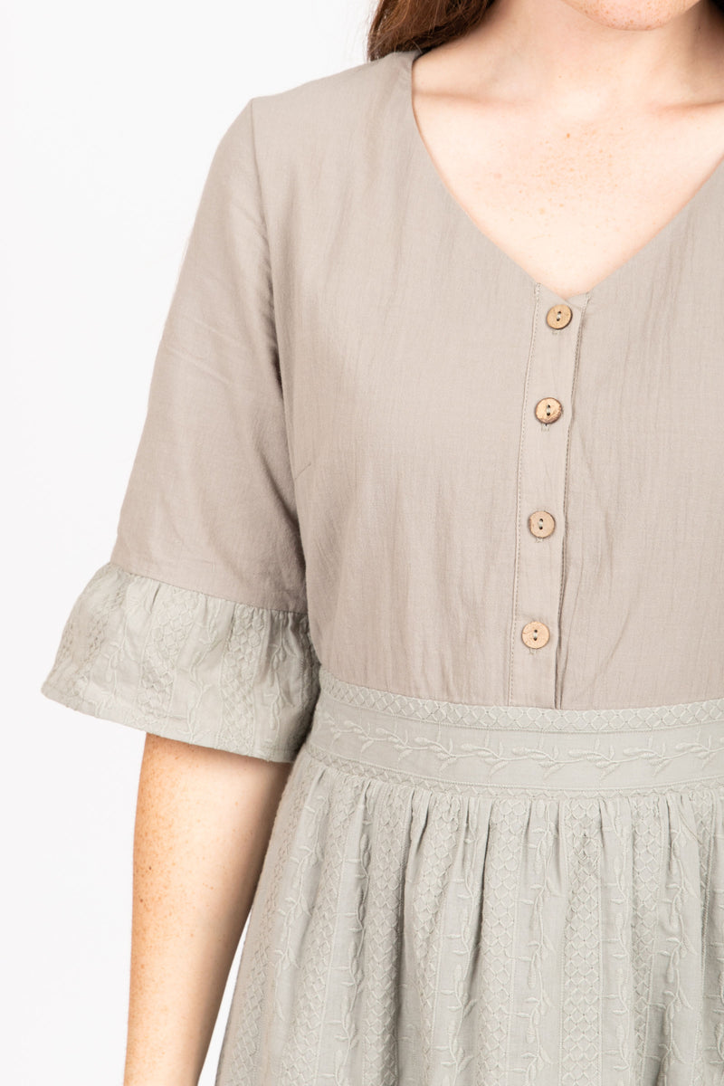 The Colby Ruffle Detail Dress in Sage, studio shoot; close up front view of arm