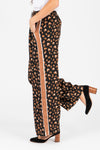 The Rene Leopard Trouser Pants in Camel, studio shoot; side view