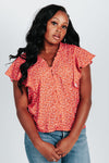 The Jonas Floral Patterned Blouse in Poppy, studio shoot; front view