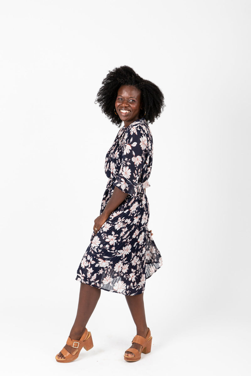 The Penny Floral Pleated Dress in Navy, studio shoot; side view