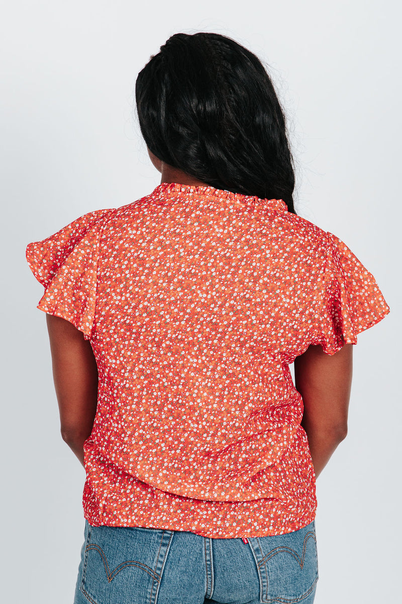 The Jonas Floral Patterned Blouse in Poppy, studio shoot; back view