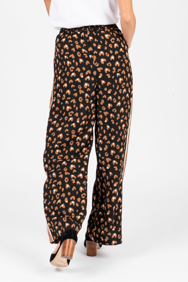 The Rene Leopard Trouser Pants in Camel, studio shoot; back view