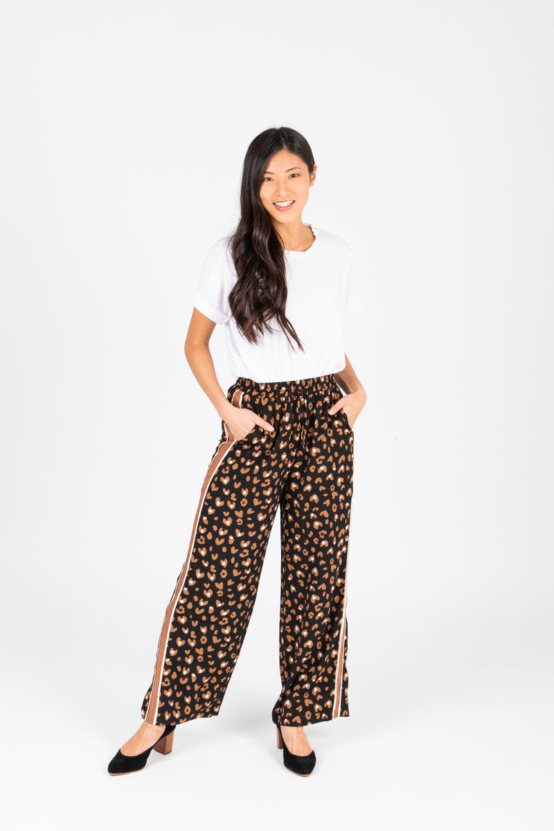 The Rene Leopard Trouser Pants in Camel, studio shoot; front view
