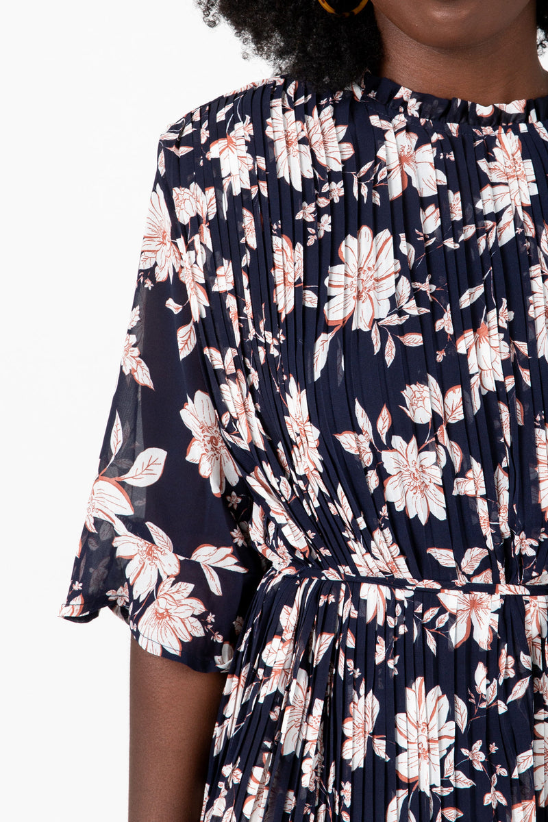 The Penny Floral Pleated Dress in Navy, studio shoot; front view