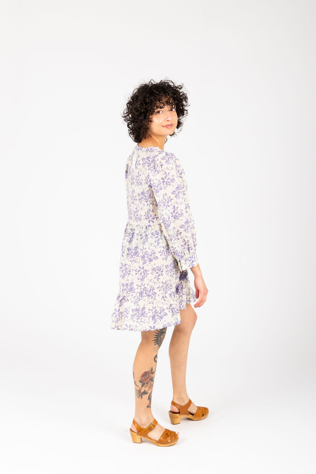 The Kian Floral Tiered Tunic in Lavender, studio shoot; side view
