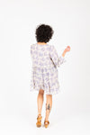 The Kian Floral Tiered Tunic in Lavender, studio shoot; back view