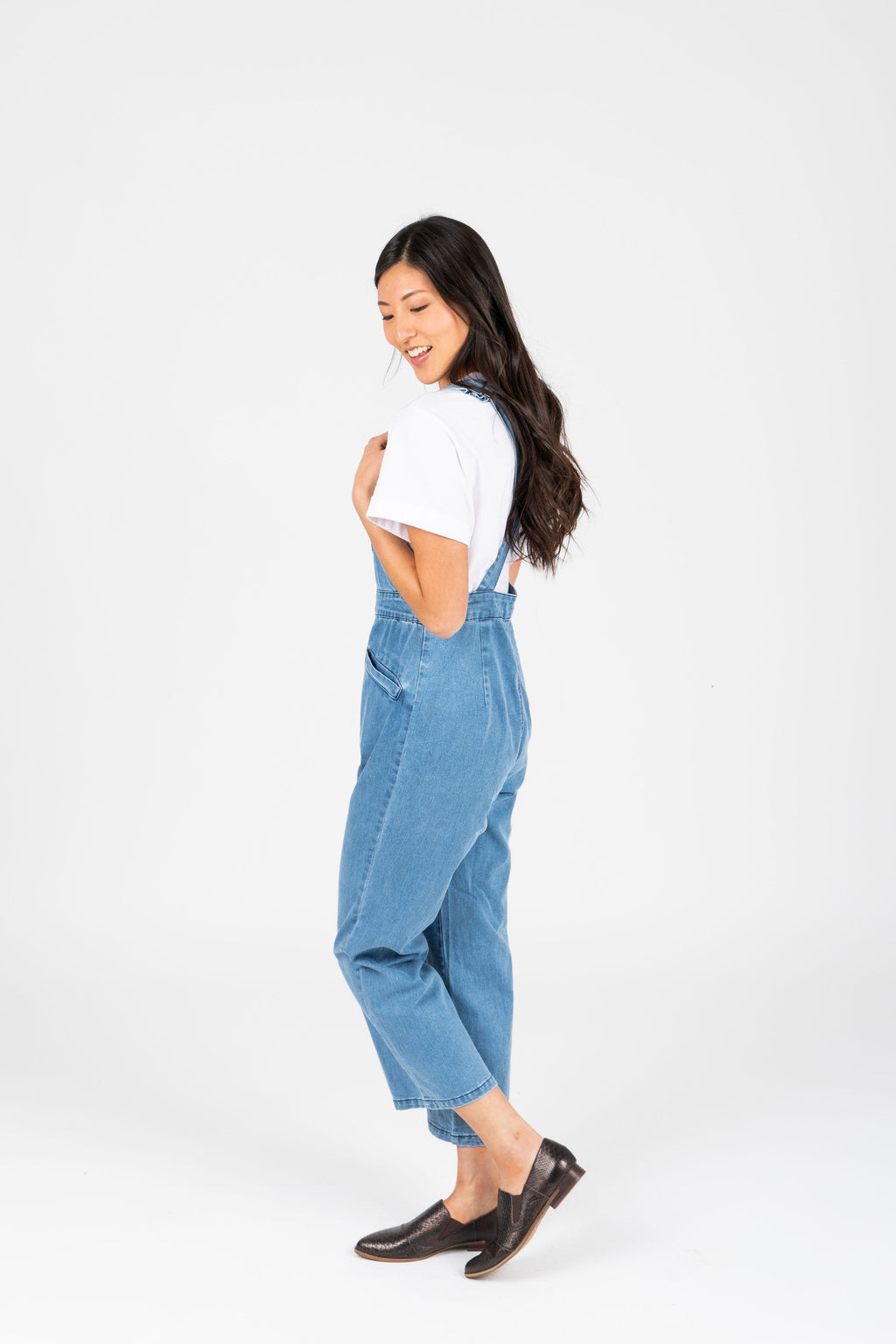 The Helene Denim Overall Pants in Light Denim, studio shoot; side view