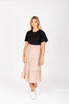 he Helena Tiered Midi Skirt in Taupe, studio shoot; front view