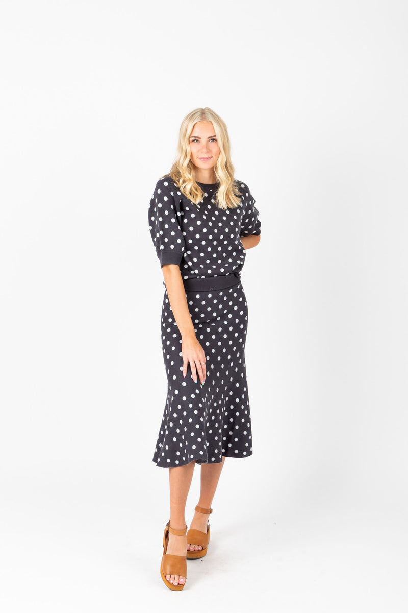 The Mitchell Dot Knit Skirt in Navy, studio shoot; front view