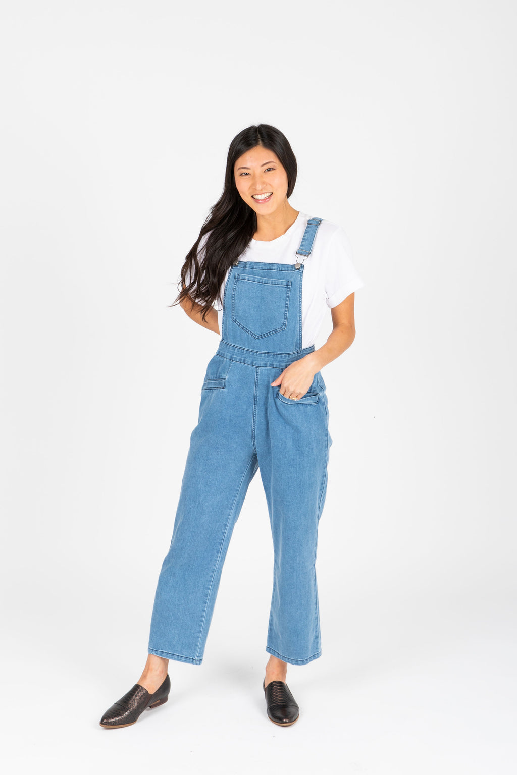The Helene Denim Overall Pants in Light Denim, studio shoot; front view