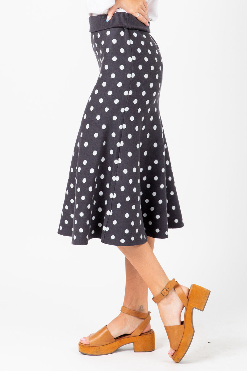 The Mitchell Dot Knit Skirt in Navy, studio shoot; side view