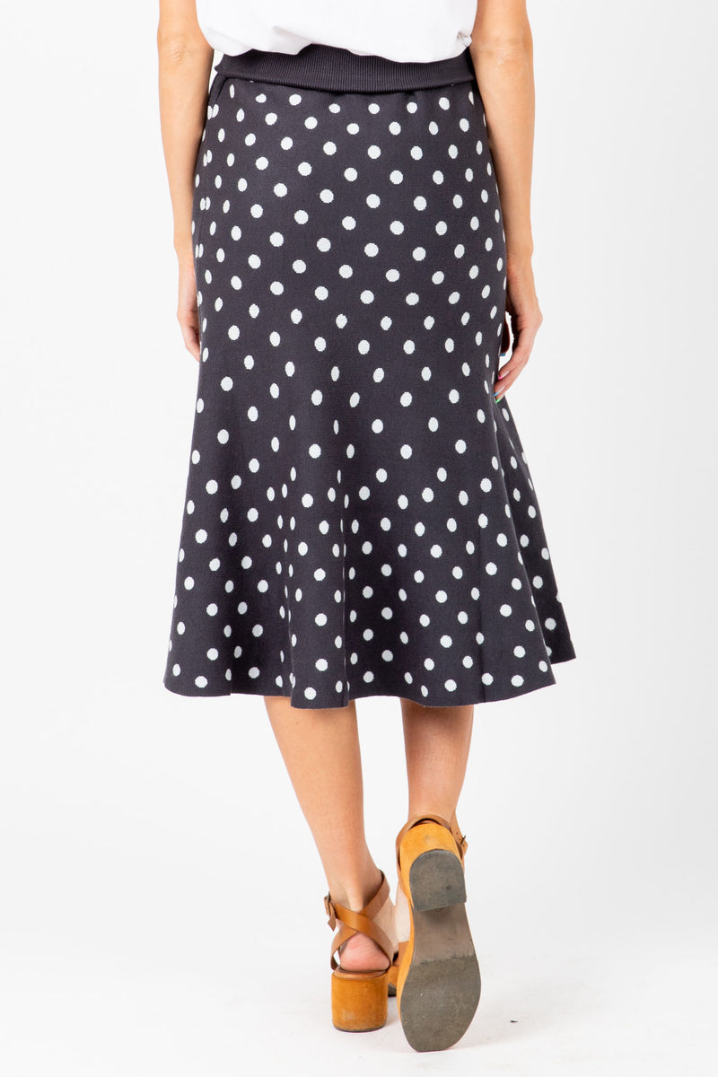 The Mitchell Dot Knit Skirt in Navy, studio shoot; back view