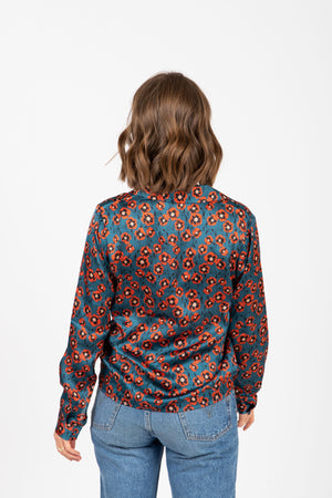 The Choice Floral Satin Blouse in Teal, studio shoot; back view