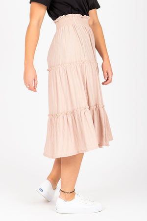 he Helena Tiered Midi Skirt in Taupe, studio shoot; side view