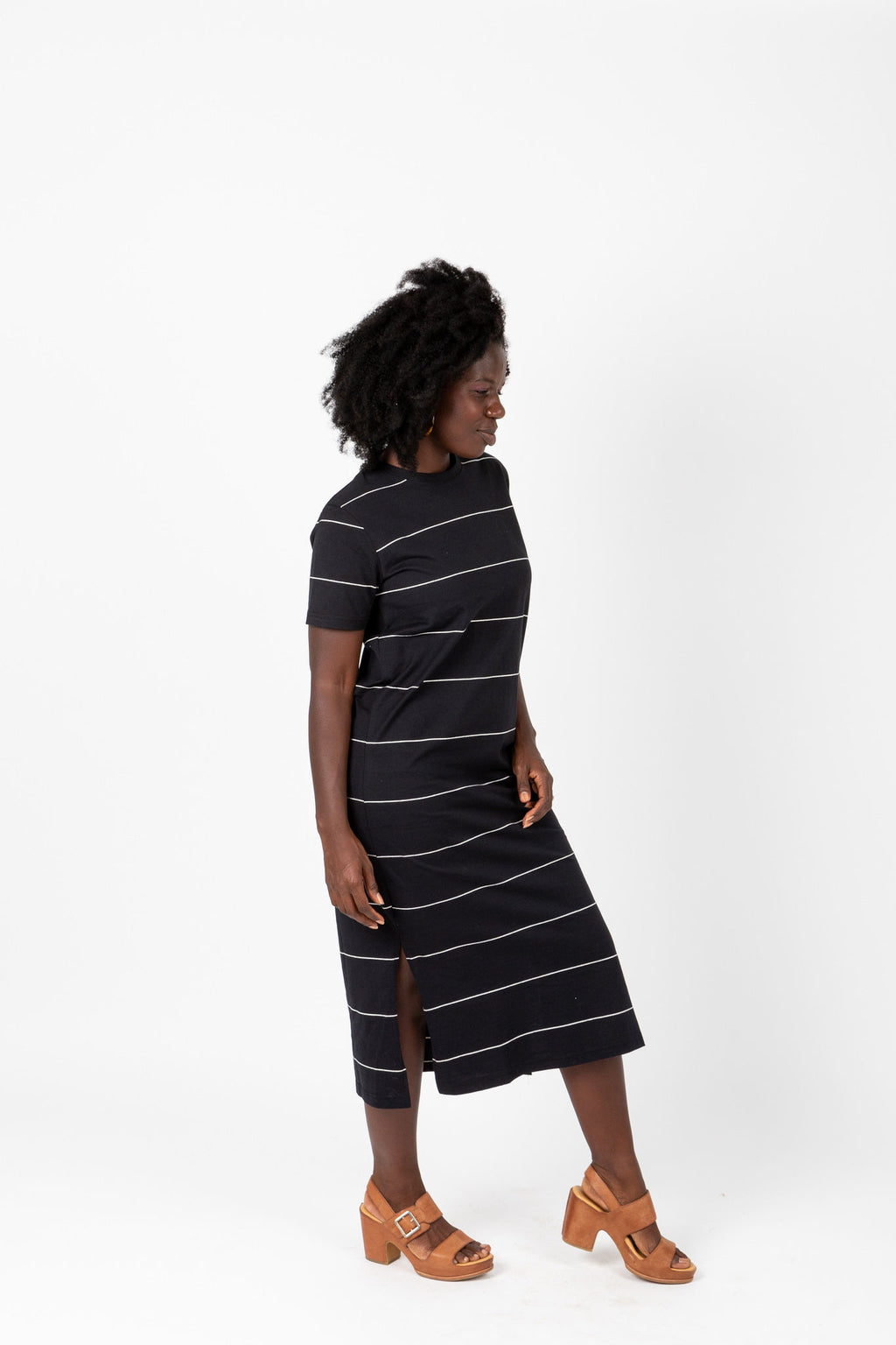 The Kate Striped Midi Dress in Black, studio shoot; side view