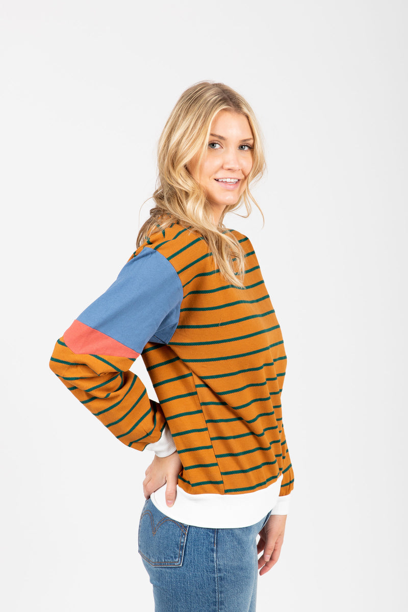 The Marlo Striped Contrast Crew Pullover in Camel, studio shoot; side view
