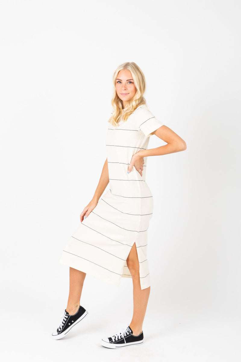 The Kate Striped Midi Dress in White, studio shoot; side view