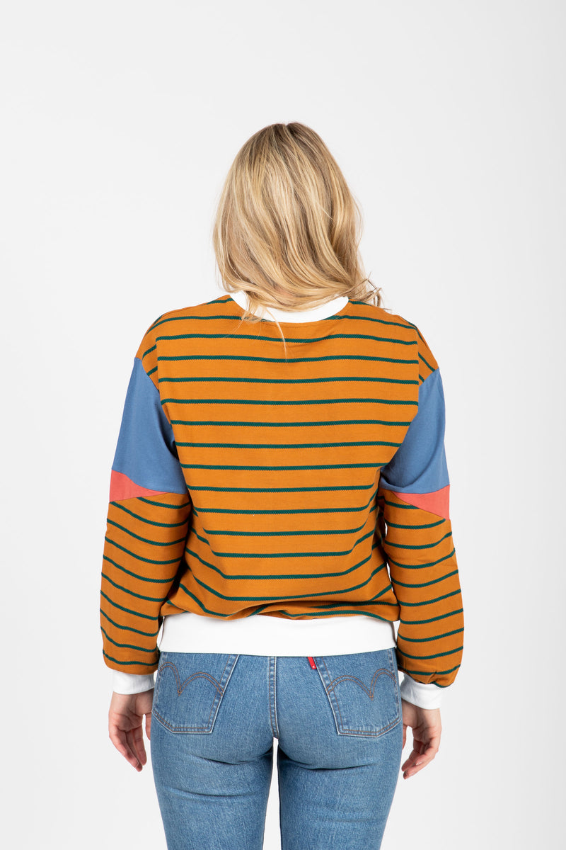 The Marlo Striped Contrast Crew Pullover in Camel, studio shoot; back view