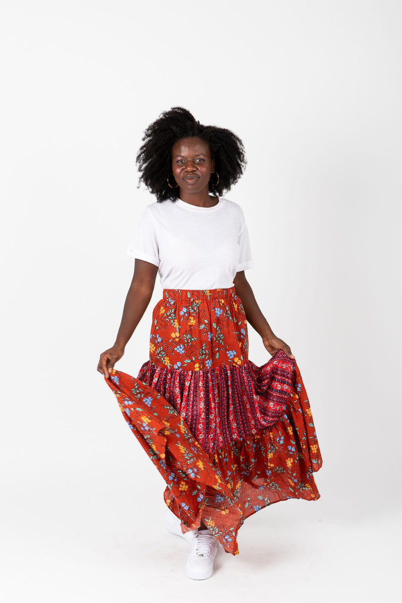 The Crimson Floral Ruffle Skirt in Red, studio shoot; front view