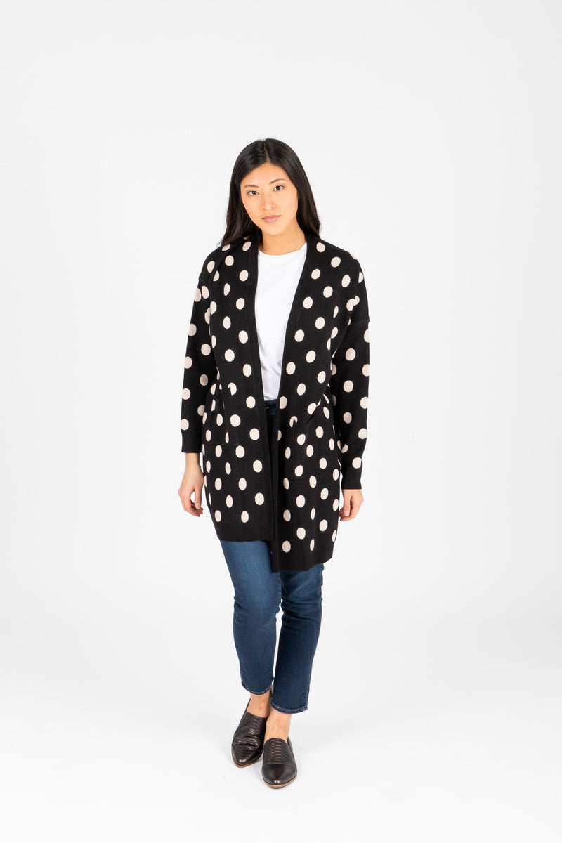 The Odette Dot Cardigan in Black, studio shoot; front view