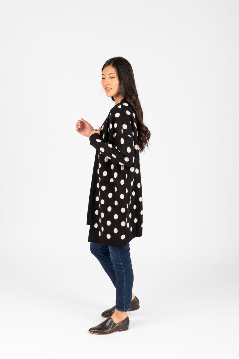 The Odette Dot Cardigan in Black, studio shoot; side view