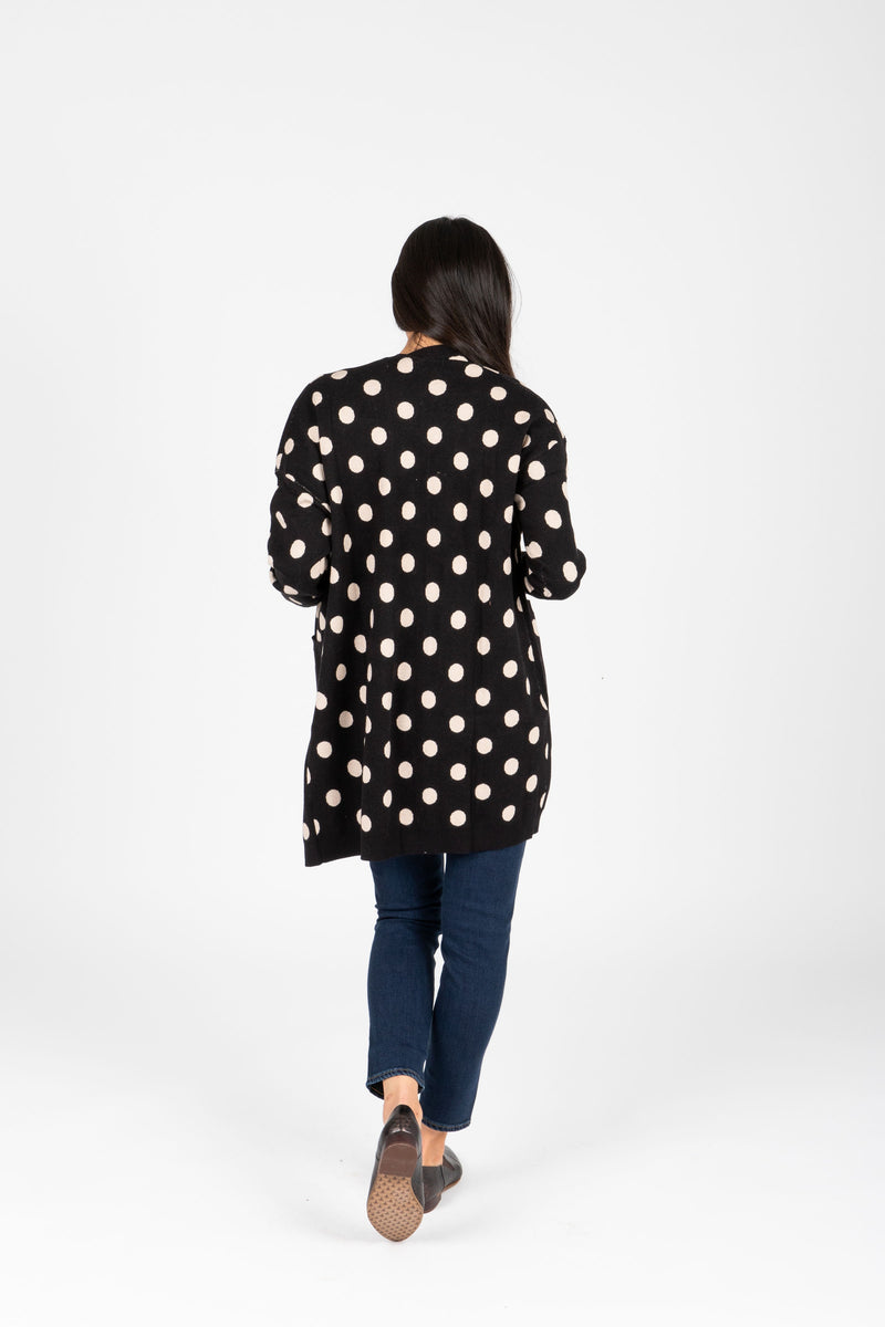 The Odette Dot Cardigan in Black, studio shoot; back view