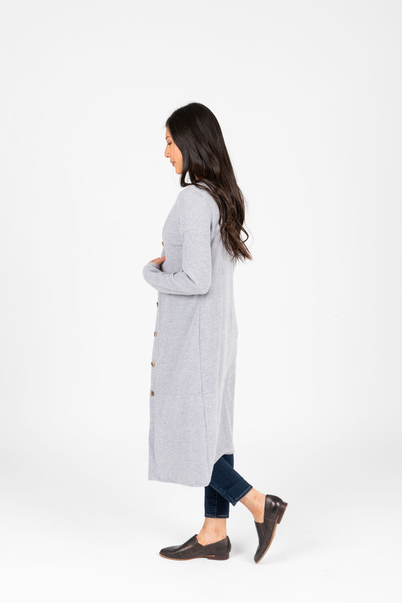 The Ripple Long Button Cardigan in Heather Grey, studio shoot; side view