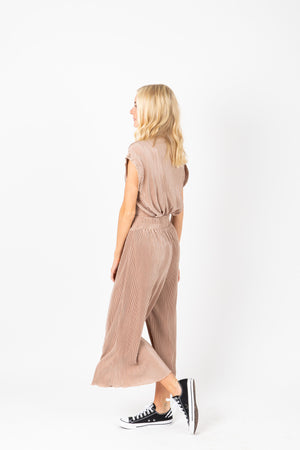The Ariana Pleated Set in Blush, studio shoot; side view