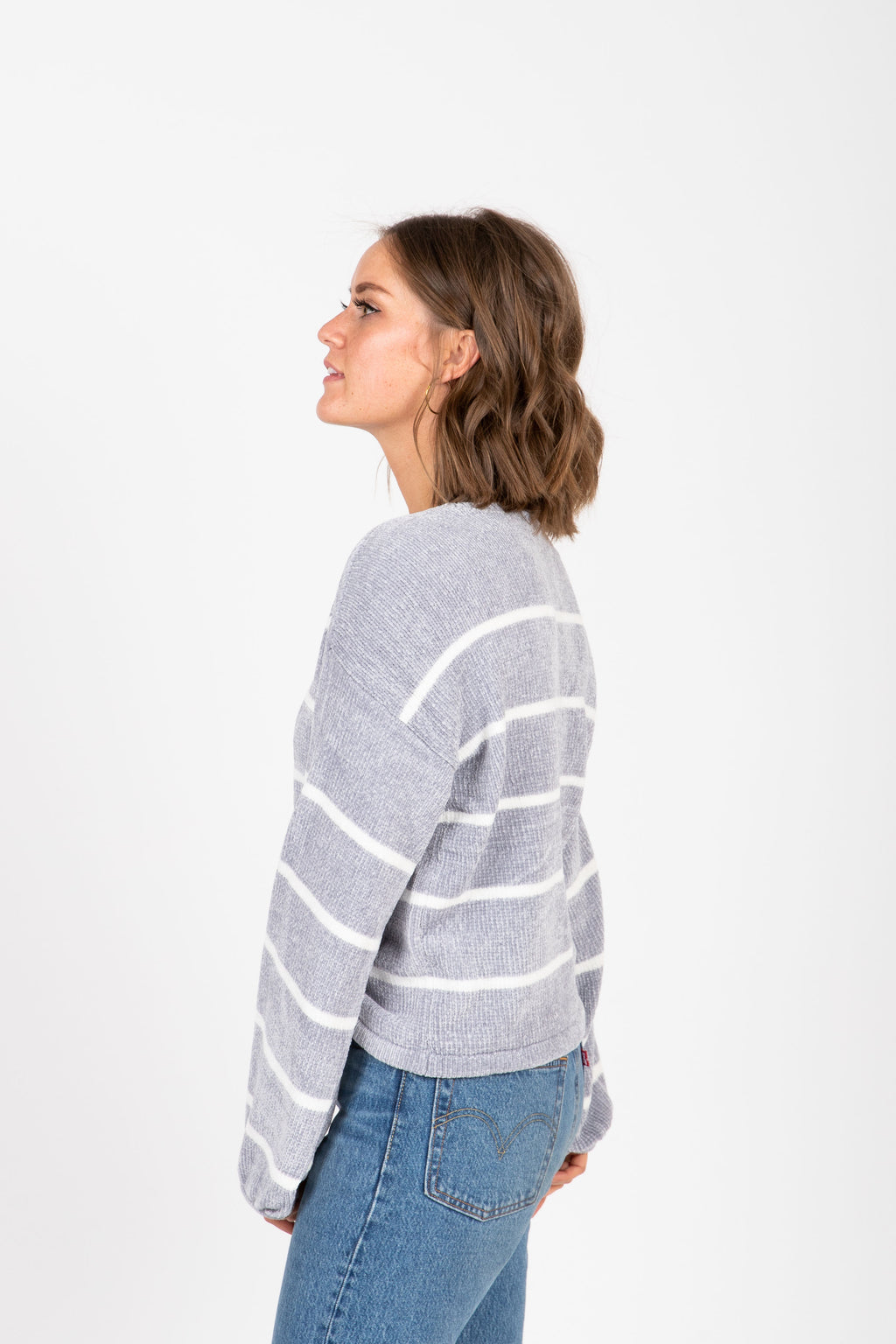 The Edge Cozy Striped Sweater in Grey, studio shoot; side view