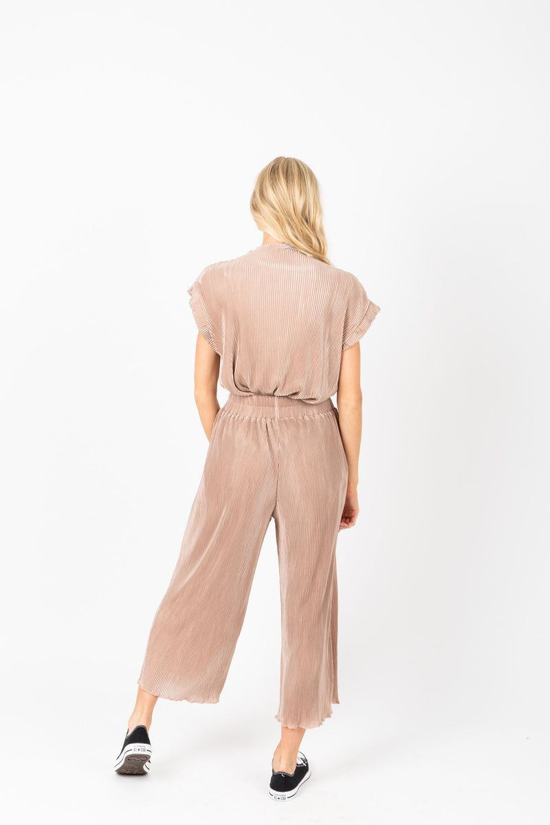 The Ariana Pleated Set in Blush, studio shoot; back view