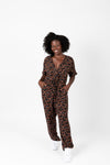 The Elliott Floral Wrap Jumpsuit in Black, studio shoot; front view