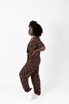The Elliott Floral Wrap Jumpsuit in Black, lifestyle shoot; side view